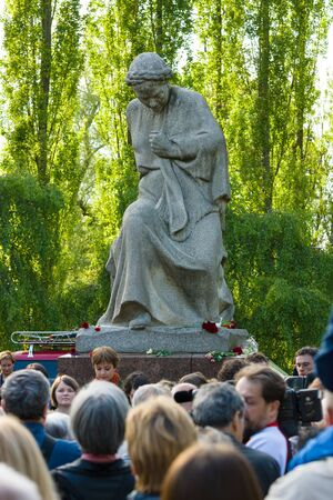 commemoration: BERLIN - MAY 08, 2015: Victory in Europe Day. Treptower Park. Anti-fascists in the commemoration ceremony near the sculpture of Motherland.