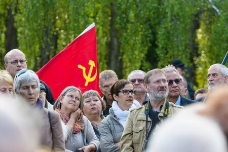 treptow: BERLIN - MAY 08, 2015: Victory in Europe Day. Treptower Park. Participants of commemorative events with the flags of the Soviet Union