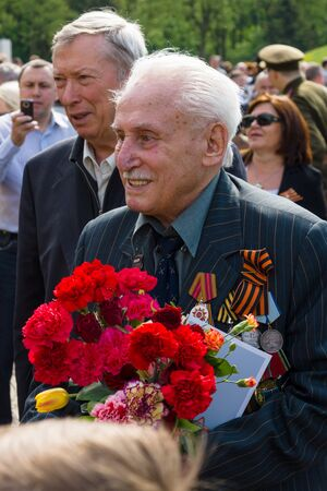 commemoration: BERLIN - MAY 09, 2015: Victory Day in Treptower Park. Great Patriotic War veteran with medals and awards.