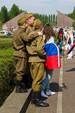nazi flag: BERLIN - MAY 09, 2015: Victory Day in Treptower Park. Soldiers in the uniform of the Red Army during the war.