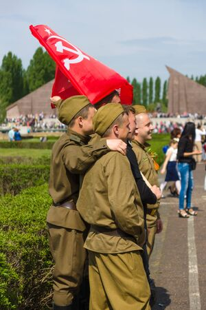 soviet flag: BERLIN - MAY 09, 2015: Victory Day in Treptower Park. Soldiers in the uniform of the Red Army during the war, and with the flag of the Soviet Union.
