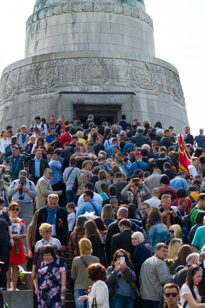 the liberator: BERLIN - MAY 09, 2015: Victory Day in Treptower Park. Many visitors to lay flowers at the monument to the Liberator Soldier. Editorial