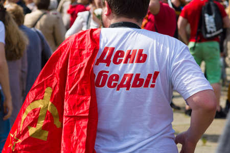 soviet flag: BERLIN - MAY 09, 2015: Victory Day in Treptower Park. The man with the flag of the Soviet Union.