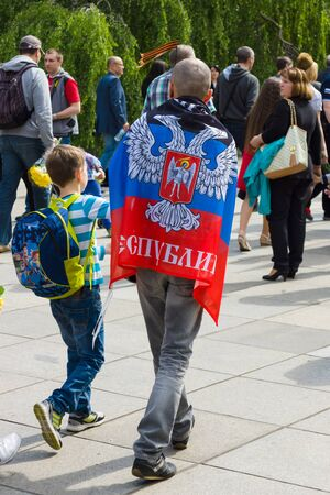 frag: BERLIN - MAY 09, 2015: Victory Day in Treptower Park. A man with a frag Donetsk Peoples Republic. Editorial