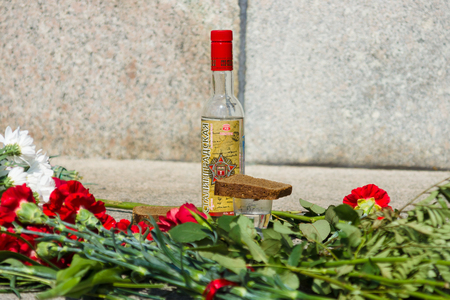 treptow: BERLIN - MAY 09, 2015: Victory Day. Vodka Stalingrad, a glass and flowers on the granite parapet of the Soviet memorial in Treptow Park. Editorial