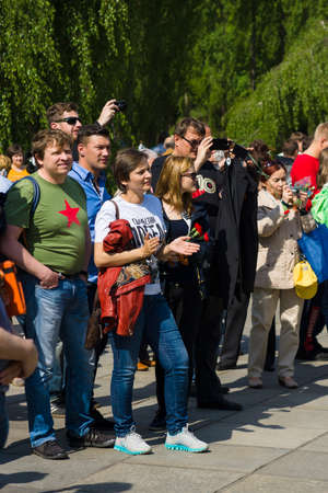 nazi flag: BERLIN - MAY 09, 2015: Victory Day in Treptower Park. Visitors to the Soviet memorial in Treptow Park.