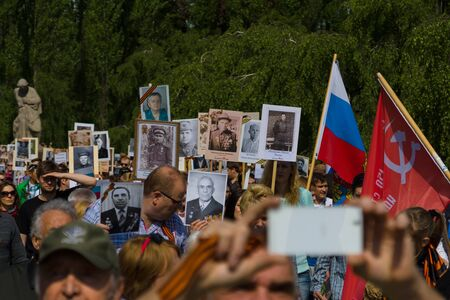 immortal: BERLIN - MAY 09, 2015: Victory Day. The action Immortal Regiment in Treptow Park.