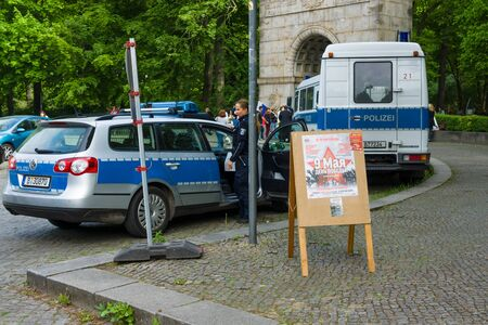 ensure: BERLIN - MAY 09, 2015: Victory Day in Treptower Park. Numerous police officers ensure order and peace at the event.