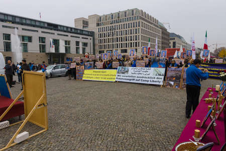 dictator: BERLIN - OCTOBER 30, 2015: The protest of the Iranian opposition in the center of Berlin, near the Brandenburg Gate.