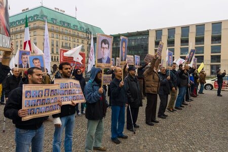 opposition: BERLIN - OCTOBER 30, 2015: The protest of the Iranian opposition in the center of Berlin, near the Brandenburg Gate.