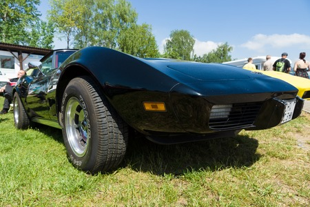 corvette: PAAREN IM GLIEN, GERMANY - MAY 19: The Chevrolet Corvette Stingray (C3) is a sports car produced by the Chevrolet division of General Motors for the 1968 through 1982 model years, The oldtimer show in MAFZ, May 19, 2013 in Paaren im Glien, Germany