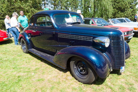 chevrolet: PAAREN IM GLIEN, GERMANY - MAY 19: The Chevrolet Master Deluxe Coupe 1938. The Chevrolet Master and Master Deluxe are American passenger vehicles manufactured by Chevrolet between 1934 and 1942, The oldtimer show in MAFZ, May 19, 2013 in Paaren im Glien