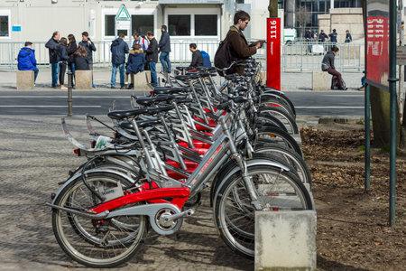 ecologists: BERLIN - APRIL 03, 2016: bicycle rental station of company Deutsche Bahn (German Railway).