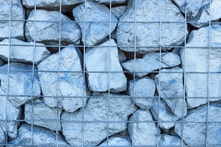 solid wire: Folded large colored stones and reinforced wire mesh. Background.