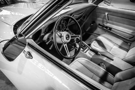 corvette: STUTTGART, GERMANY - MARCH 17, 2016: Cabin of sports car Chevrolet Corvette Stingray Coupe (C3), 1975. Black and white. Europes greatest classic car exhibition RETRO CLASSICS Editorial