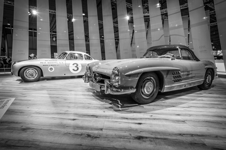 classics: STUTTGART, GERMANY - MARCH 17, 2016: Racing car Mercedes-Benz 300 SL (W194) and the sports car Mercedes-Benz 300 SL Roadster (W198). Black and white. Europes greatest classic car exhibition RETRO CLASSICS