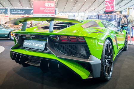 lamborghini: STUTTGART, GERMANY - MARCH 17, 2016: Mid-engined sports car Lamborghini Aventador LP 750-4 SuperVeloce, 2016. Rear view. Europes greatest classic car exhibition RETRO CLASSICS