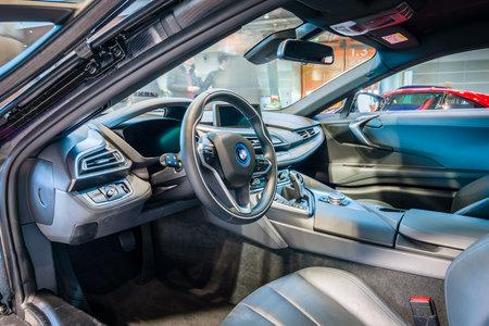 hdri: STUTTGART, GERMANY - MARCH 17, 2016: Cabin of a plug-in hybrid sports car BMW i8. HDRi. Europes greatest classic car exhibition RETRO CLASSICS Editorial