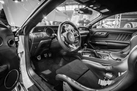 mustang gt: STUTTGART, GERMANY - MARCH 17, 2016: Cabin of pony car Ford Mustang GT fastback coupe (sixth generation), 2015. Black and white. Europes greatest classic car exhibition RETRO CLASSICS Editorial