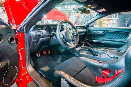 the sixth: STUTTGART, GERMANY - MARCH 17, 2016: Cabin of pony car Ford Mustang GT fastback coupe (sixth generation), 2015. HDRi. Europes greatest classic car exhibition RETRO CLASSICS Editorial