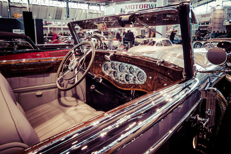 stylization: STUTTGART, GERMANY - MARCH 17, 2016: Cabin of full-size luxury car Mercedes-Benz 770K Cabriolet D (W07), 1931. Toning. Stylization. Europes greatest classic car exhibition RETRO CLASSICS Editorial