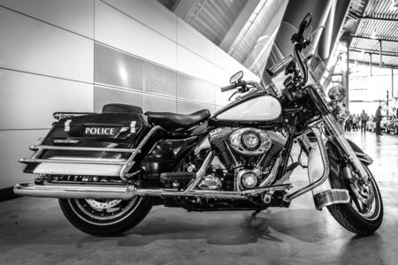 a white police motorcycle: STUTTGART, GERMANY - MARCH 17, 2016: Motorcycle Harley-Davidson FLHR Police, 2008. Black and white. Europes greatest classic car exhibition RETRO CLASSICS