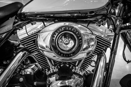 a white police motorcycle: STUTTGART, GERMANY - MARCH 17, 2016: Engine of motorcycle Harley-Davidson FLHP Police, 2008. Black and white. Europes greatest classic car exhibition RETRO CLASSICS Editorial