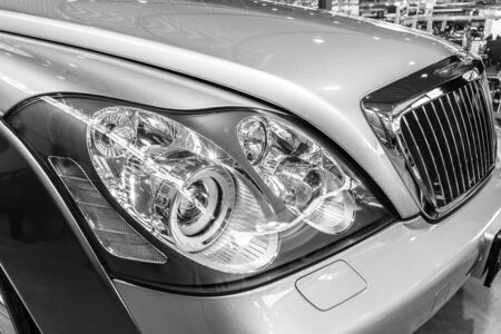 classics: STUTTGART, GERMANY - MARCH 17, 2016: Headlamp of full-size luxury car Maybach 57S, 2006. Black and white. Europes greatest classic car exhibition RETRO CLASSICS Editorial