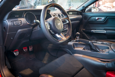 mustang gt: STUTTGART, GERMANY - MARCH 17, 2016: Cabin of pony car Ford Mustang GT fastback coupe (sixth generation), 2015. Europes greatest classic car exhibition RETRO CLASSICS