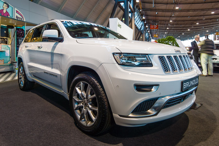 cherokee: STUTTGART, GERMANY - MARCH 17, 2016: Mid-size luxury crossover SUV Jeep Grand Cherokee, 2015. Europes greatest classic car exhibition RETRO CLASSICS
