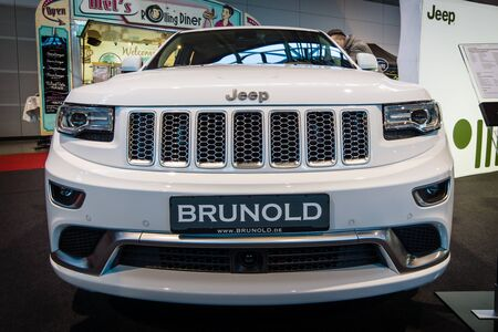 crossover: STUTTGART, GERMANY - MARCH 17, 2016: Mid-size luxury crossover SUV Jeep Grand Cherokee, 2015. Europes greatest classic car exhibition RETRO CLASSICS