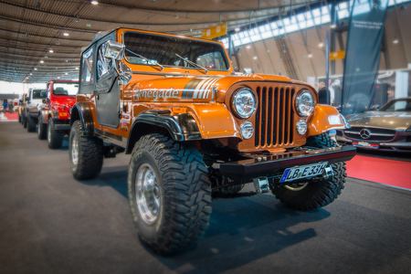STUTTGART, GERMANY - MARCH 17, 2016: Off-road Jeep Wrangler Renegade, 1994.Tilt-Shift. Europe's greatest classic car exhibition