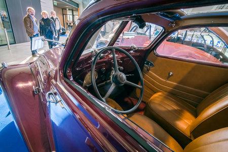 hdri: STUTTGART, GERMANY - MARCH 17, 2016: Cabin of large family car Peugeot 402 Legere E, 1939. HDRi. Europes greatest classic car exhibition RETRO CLASSICS