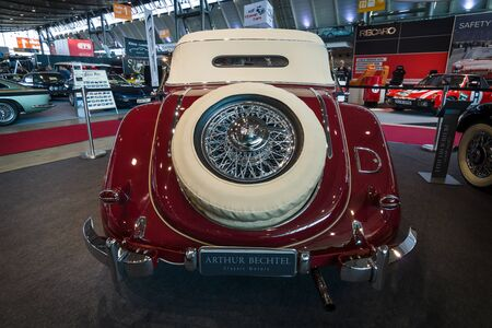 typ: STUTTGART, GERMANY- MARCH 17, 2016: Vintage car Mercedes-Benz Typ 320 (W142) Cabriolet A, 1938. Rear view. Europes greatest classic car exhibition RETRO CLASSICS