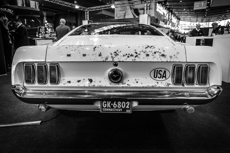 high performance: STUTTGART, GERMANY - MARCH 17, 2016: High performance Ford Mustang variant, Boss 429, 1969. Rear view. Black and white. Europes greatest classic car exhibition RETRO CLASSICS