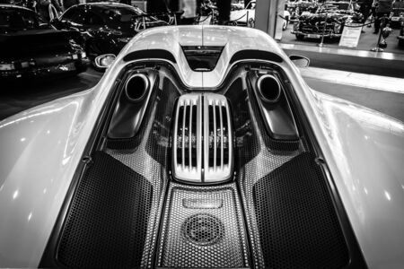 plugin: STUTTGART, GERMANY - MARCH 17, 2016: The engine compartment of a mid-engined plug-in hybrid sports car Porsche 918 Spyder, 2015. Close-up. Black and white. Europes greatest classic car exhibition RETRO CLASSICS