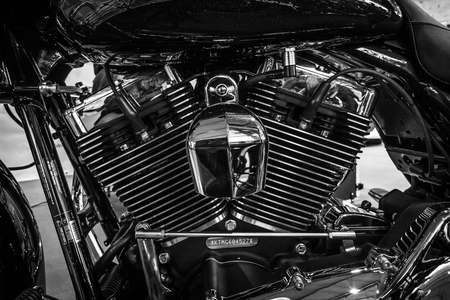 twin engine: STUTTGART, GERMANY - MARCH 17, 2016: Fragment of a motorcycle Harley-Davidson Road Glide, 2016. Black and white. Europes greatest classic car exhibition RETRO CLASSICS Editorial