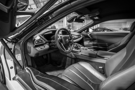 plugin: STUTTGART, GERMANY - MARCH 17, 2016: Cabin of a plug-in hybrid sports car BMW i8. Black and white. Europes greatest classic car exhibition RETRO CLASSICS