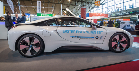 plugin: STUTTGART, GERMANY - MARCH 17, 2016: Plug-in hybrid sports car BMW i8. Europes greatest classic car exhibition RETRO CLASSICS
