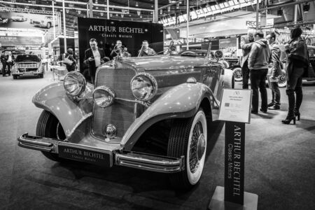 typ: STUTTGART, GERMANY- MARCH 17, 2016: Luxury car Mercedes-Benz Typ 290 Roadster (W18), 1935. Black and white.  Europes greatest classic car exhibition RETRO CLASSICS