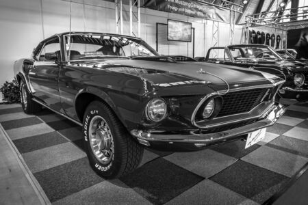 mach: STUTTGART, GERMANY - MARCH 17, 2016: Pony car Ford Mustang Mach 1 Sportsroof, 1969. Black and white. Europes greatest classic car exhibition RETRO CLASSICS Editorial
