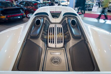 engine compartment: STUTTGART, GERMANY - MARCH 17, 2016: The engine compartment of a mid-engined plug-in hybrid sports car Porsche 918 Spyder, 2015. Close-up. Europes greatest classic car exhibition RETRO CLASSICS