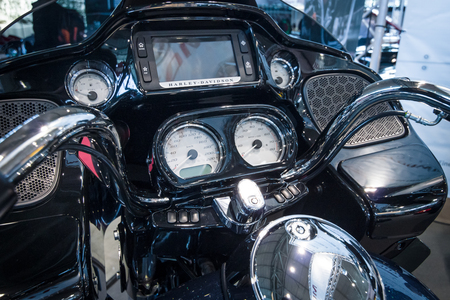 glide: STUTTGART, GERMANY - MARCH 17, 2016: The dashboard of a motorcycle Harley-Davidson Road Glide, 2016. Europes greatest classic car exhibition RETRO CLASSICS Editorial