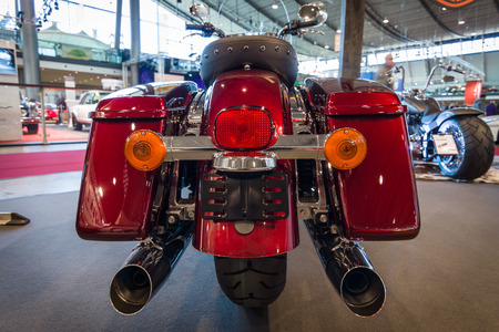 classics: STUTTGART, GERMANY - MARCH 17, 2016: Motorcycle Harley-Davidson Road King, 2016. Rear view. Europes greatest classic car exhibition RETRO CLASSICS Editorial