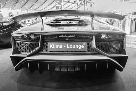 lp: STUTTGART, GERMANY - MARCH 17, 2016: Mid-engined sports car Lamborghini Aventador LP 750-4 SuperVeloce, 2016. Rear view. Black and white. Europes greatest classic car exhibition RETRO CLASSICS