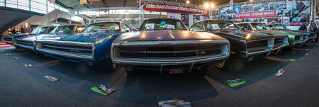 rt: STUTTGART, GERMANY - MARCH 17, 2016: Various Dodge Charger (Muscle car), modesl 500 and RT are standing in a row. Panoramic view. Europes greatest classic car exhibition RETRO CLASSICS