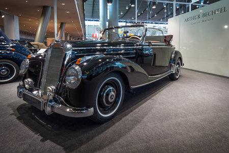 classics: STUTTGART, GERMANY- MARCH 17, 2016: Full-size luxury car Mercedes-Benz 220 Cabriolet A (W187), 1952. Europes greatest classic car exhibition RETRO CLASSICS Editorial