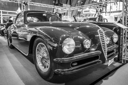 alfa: STUTTGART, GERMANY - MARCH 17, 2016: Vintage car Alfa Romeo 6C 2500 SS Touring Superleggera Coupe, 1948. Black and white. Europes greatest classic car exhibition RETRO CLASSICS