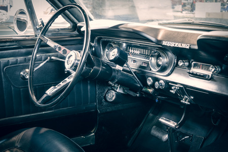 stylization: STUTTGART, GERMANY - MARCH 18, 2016: Cabin of Ford Mustang Fastback, 1965. Stylization. Toning. Europes greatest classic car exhibition RETRO CLASSICS Editorial