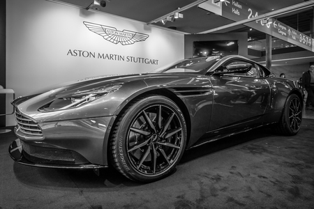 STUTTGART, GERMANY - MARCH 18, 2016: Grand tourer coupe Aston Martin DB10, 2016. Black and white. Europe's greatest classic car exhibition